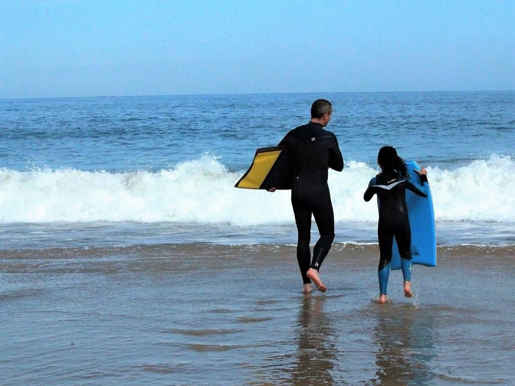 Father and daughter boogieboarding