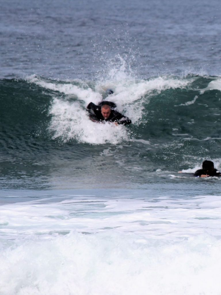 bodyboarder catching a wave