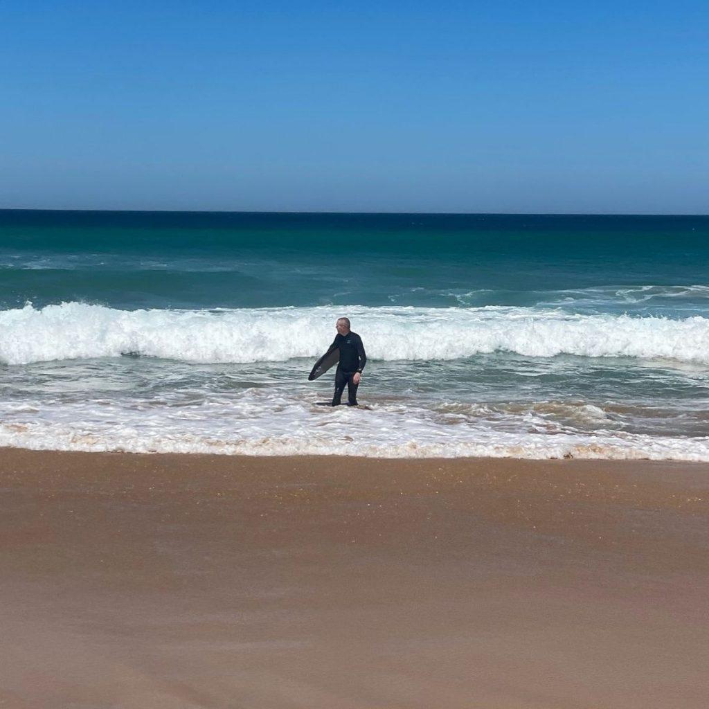Bodyboarder entering the ocean
