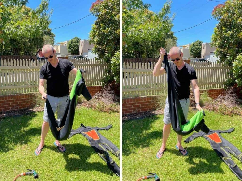 Washing wetsuits with a hose in the garden