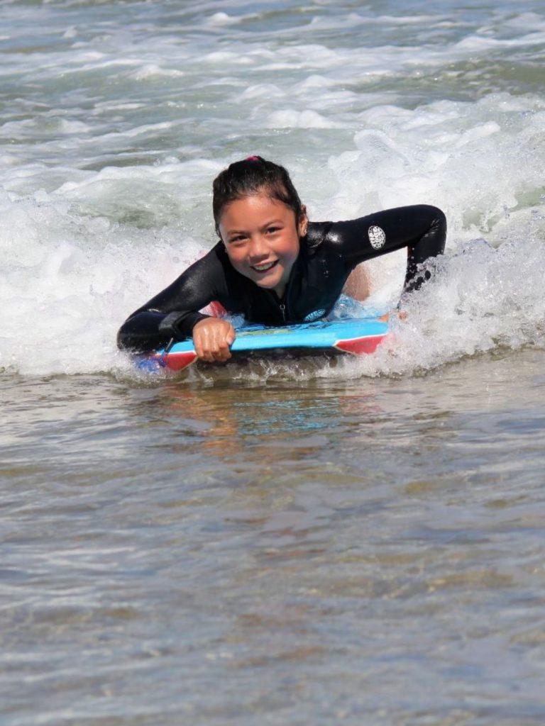 Girl bodyboarding in the surf