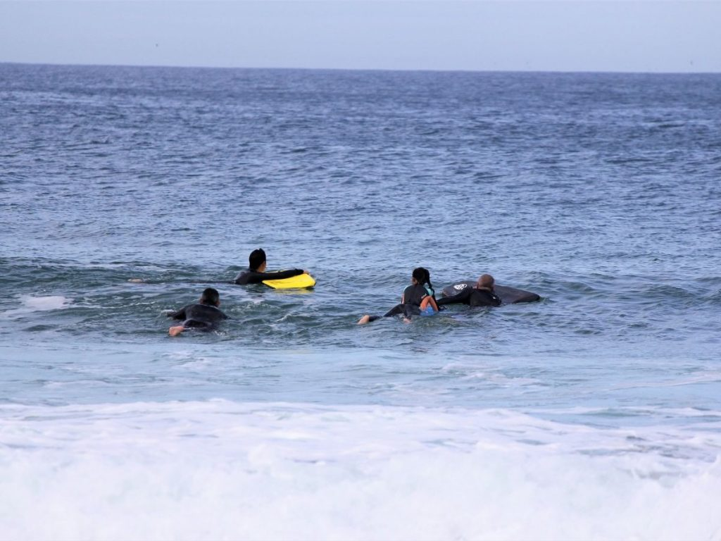 bodyboarders patiently waiting for the right wave