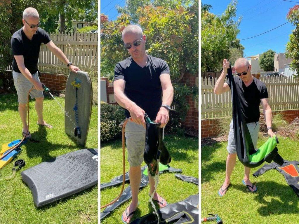 Man washing bodyboarding equipment