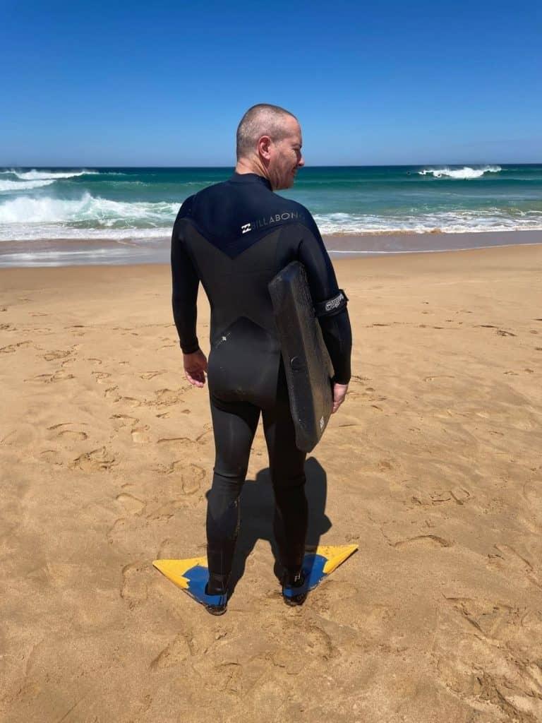 Wearing bodyboarding fins on the beach